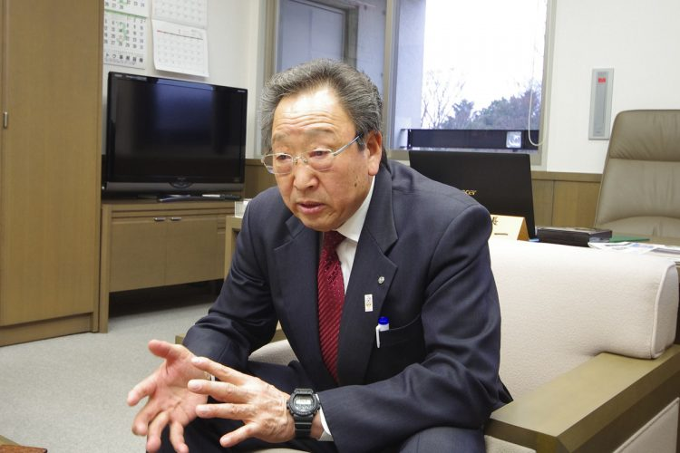Tomioka Mayor Koichi Miyamoto speaks about the town's reconstruction efforts.
