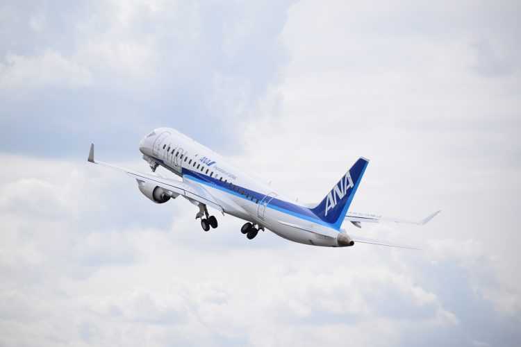 The domestically made regional passenger jet Mitsubishi Regional Jet flies over British skies at the Farnborough International Airshow.