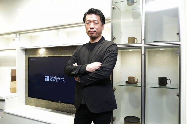 Estorage President Katsunori Yajima poses at the company's Ginza showroom.